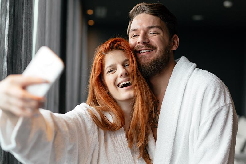 couple having a spa day, day spa, bathrobes, man and woman couple